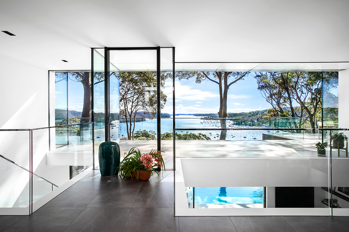 floor to ceiling windows look out at bay